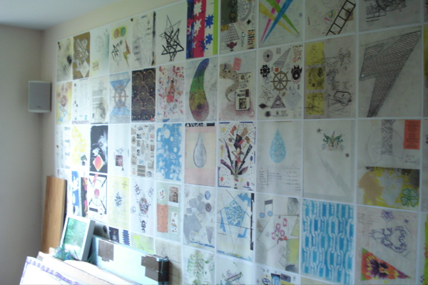 Once a year he Xeroxes the separate drawings then makes a wallpaper size print out of them (here hanging from west wall in his studio above desk).
