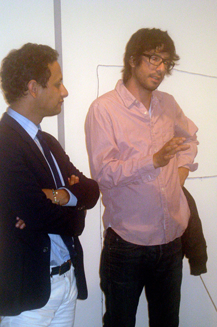 Jens Hoffmann (left) interviewing Mario Garcia Torres (right) at opening of Passengers exhibition Tuesday