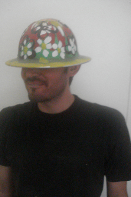 Skyler Haskard modeling hardhat with Pettibon customization.