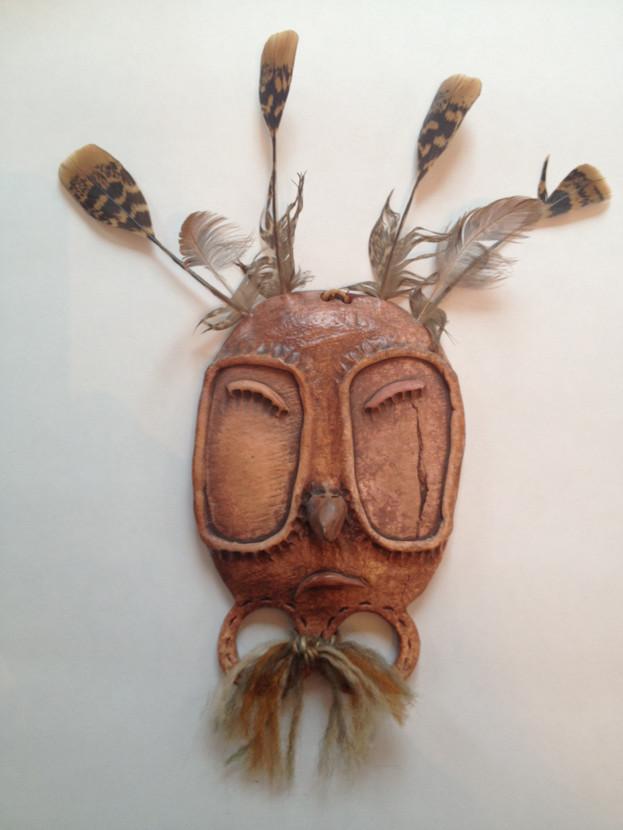 Jeanne Johnson (1950 - 2016). Yup'ik Mask; clay, feather, fingerprints, yarn.