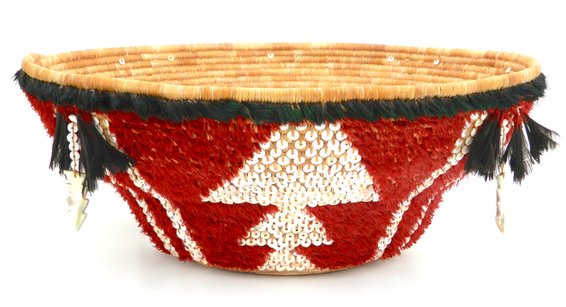 Commissioned by the Oakland Museum of California, this ceremonial feathered basket is now featured in their Gallery of California History. It contains more than 19,000 stitches, nearly 200 willow sticks, and 1200 handmade shell beads. If placed end-to-end, the weaving strands would stretch the length of four football fields. Photo by Linda Yamane.