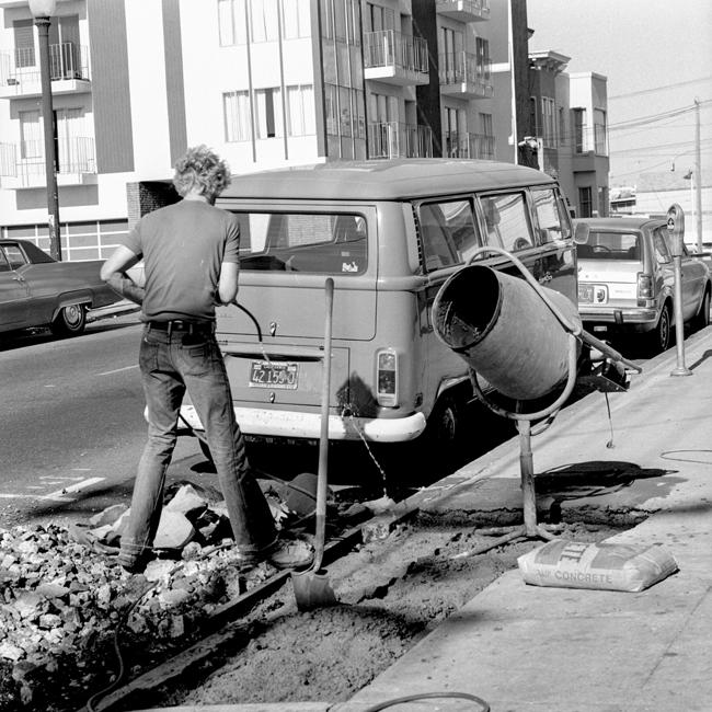 David Ireland repairing the sidewalk, 500 Capp Street, 1976; photo: Tom Marioni; image courtesy of The 500 Capp Street Foundation.