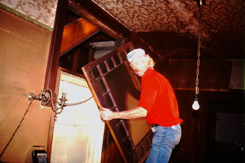 David Ireland working inside 500 Capp Street, c.1976; photo: Steven Kayfetz; image courtesy of The 500 Capp Street Foundation.