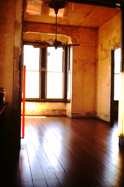 View of front parlor room at 500 Capp Street, with applied polyurethane varnish on the walls and ceiling, c.1977; photo: David Ireland; image courtesy of The 500 Capp Street Foundation.