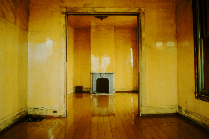 View of the back parlor room at 500 Capp Street, with applied polyurethane varnish on the floor, walls and ceiling, c.1977; photo: David Ireland; image courtesy of The 500 Capp Street Foundation.