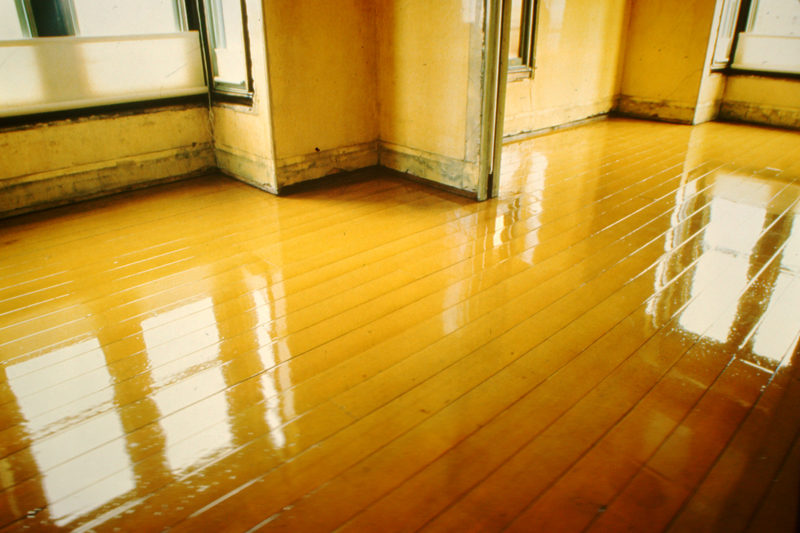 View of the back and front parlor floor at 500 Capp Street with applied polyurethane varnish, c.1977; photo: David Ireland; image courtesy of The 500 Capp Street Foundation.