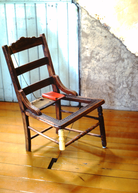David Ireland, Three-Legged Chair, 1978; wood chair, journal, and metal chain; 30 ½ x 18 x 17 inches; photo: Abe Frajndlich; image courtesy of The 500 Capp Street Foundation.