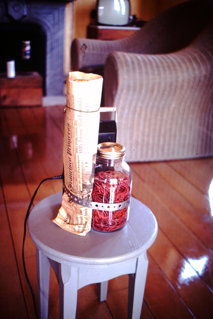 Tape recorder, newspaper, jar with rubber bands on wooden stool, c. 1977; photo: David Ireland; image courtesy of The 500 Capp Street Foundation.