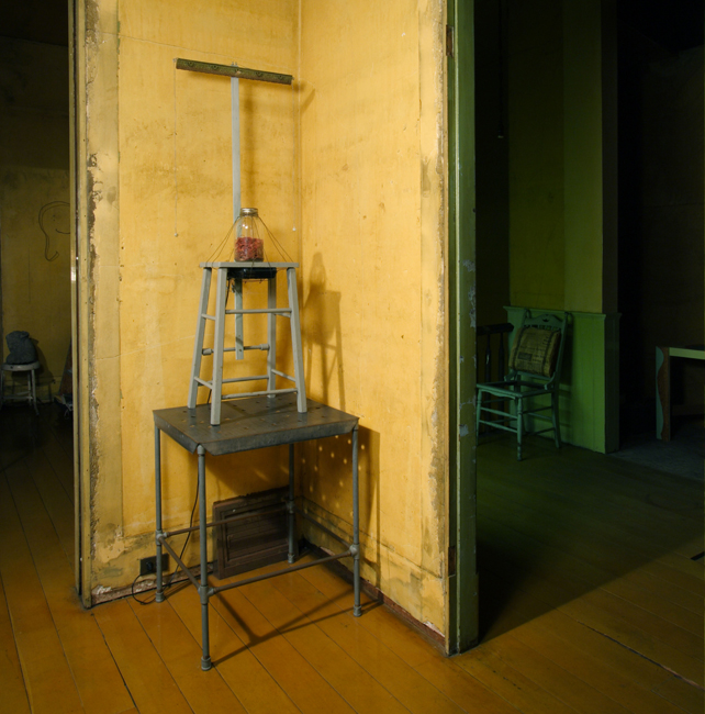 David Ireland, Rubber Band Collection with Sound Accompaniment (1977), 1986; rubber bands, glass jar, wire, wood stool, wood molding, tape recorder, and earphones; 54 ½ x 20 ½ x 13 ½ inches; photo: Joe Schopplein; image courtesy of The 500 Capp Street Foundation.
