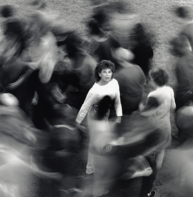Anna Halprin surrounded by dancers during a performance of <em>Circle the Earth</em>, circa 1980s. Anna Halprin Papers, The Elyse Eng Dance Collection, Museum of Performance + Design.