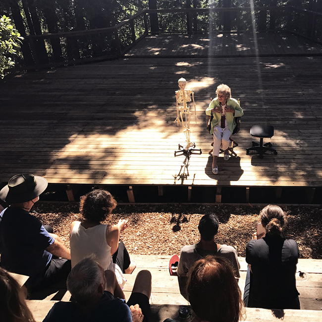 Anna Halprin shares instructions for a seated movement improvisation on the dance deck, July 26, 2017. Photo by Sophia Wang.
