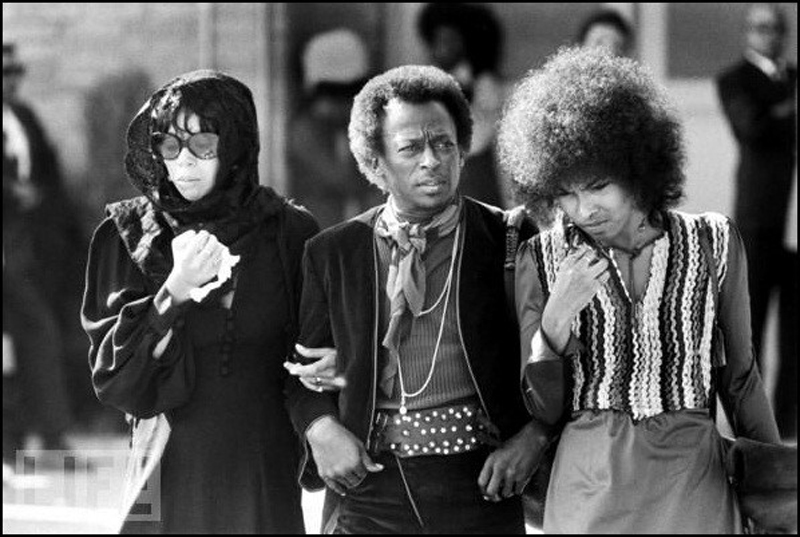 Betty Mabry, Miles Davis, and an unidentified womanattending the funeral of Jimi Hendrix. Photographer unknown.
