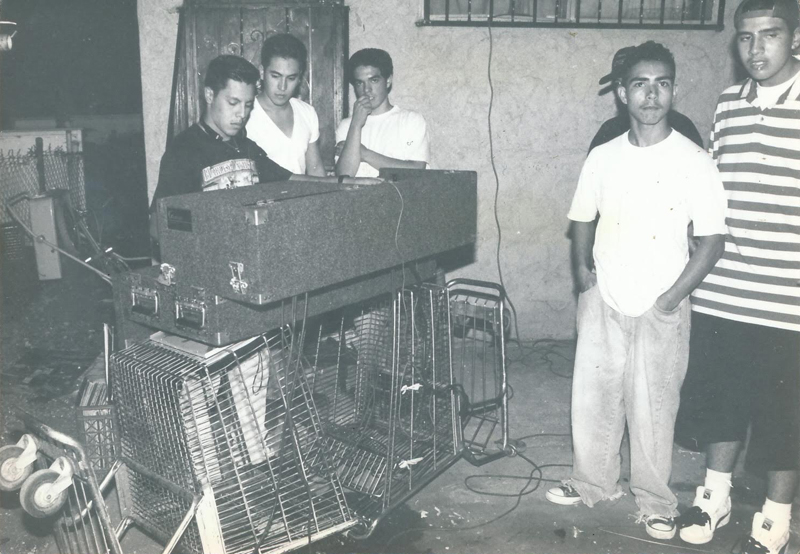 From a house party in East Los Angeles, 1993, hosted by party crew East LA Madness. Photographer unknown.