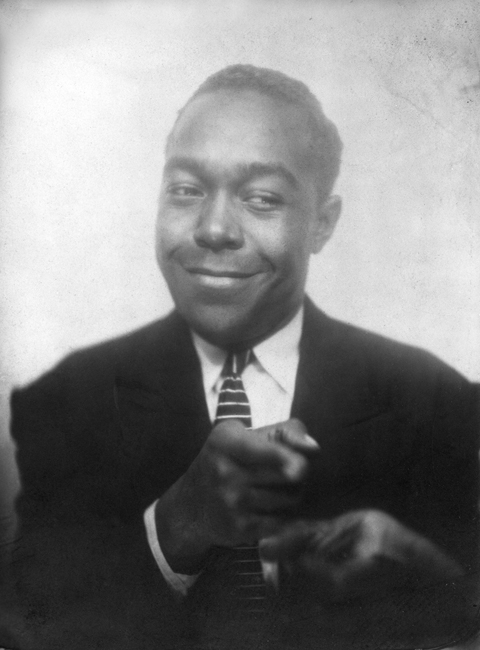 Charlie Parker in a photo booth, Kansas City, 1940.