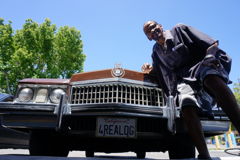 Diamond Jim in front of his ride with customized license plates. Photo credit: Pendarvis Harshaw.