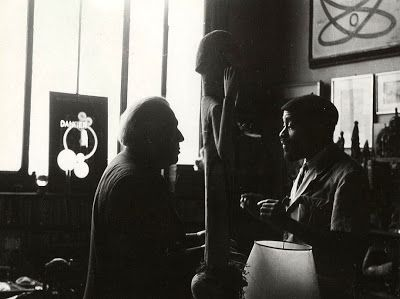 André Breton and Ted Joans in Breton's Paris apartment, photographer unknown.