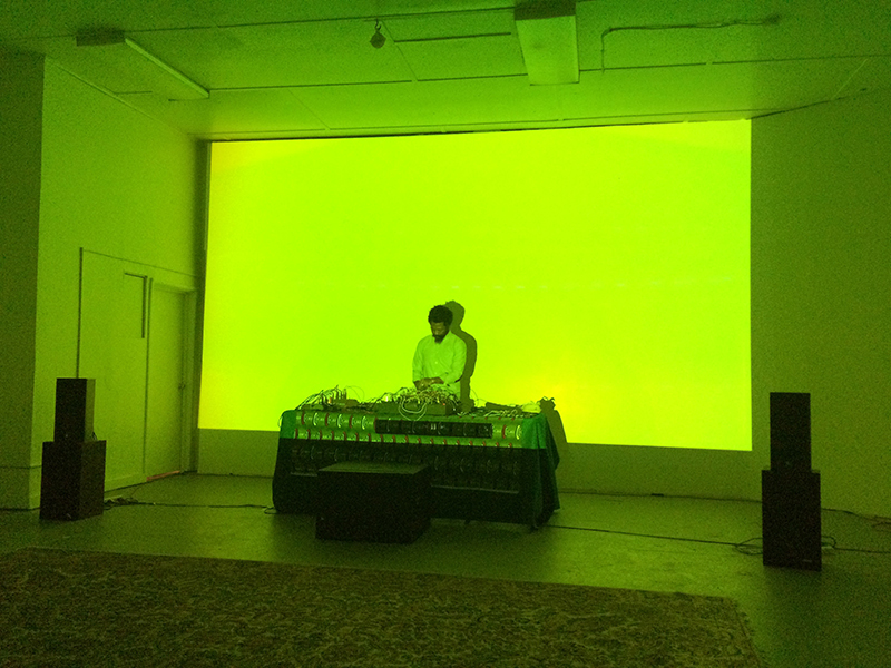 Robert Aiki Aubrey Lowe performing at LAND AND SEA, 2016.