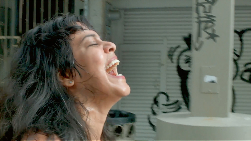 Xandra Ibarra, performance video still from Nude Laughing in San Juan, Puerto Rico, 2016. Video documentation by Adrian Perez.