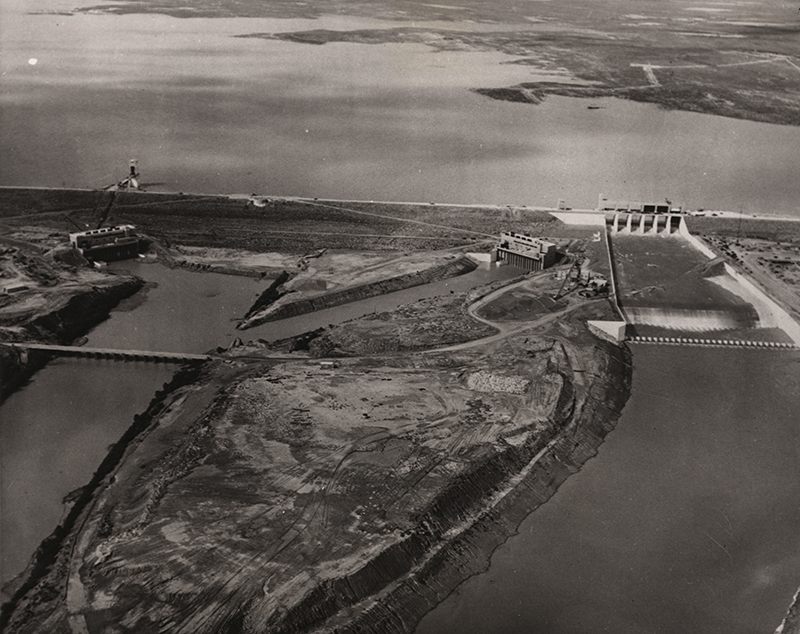 Unknown, Airview of new dam, 1953. Falcon Dam on the Rio Grande, with hydroelectric plants on both the US side and the Mexican side. Source: Library of Congress.