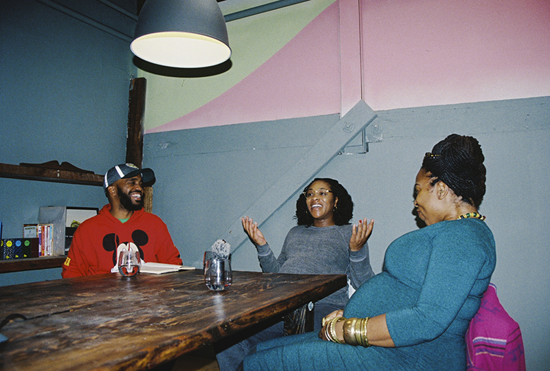 Pendarvis Harshaw, Talia Taylor, and Candice Antique sitting around a table at Sprinkle Lab in West Oakland. Photo: Sasha Kelly.