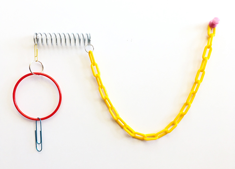 """Casual Learning Environment No. 8, 2018; paper clips, metal and plastic rings, metal spring, plastic chain, push pin, 5.75"""" x 6"""" x 2.5"""". All works by Jessalyn Aaland."""