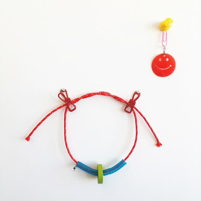 """Casual Learning Environment No. 9, 2018, wooden block, plastic toy, rope, push pin, 5"""" x 4"""" x 2"""""""