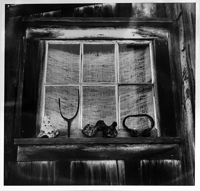 Exterior shot of bunkhouse window with artifacts from Richardson Bay. From the Dave Lemon and Jerry O'Day collection.
