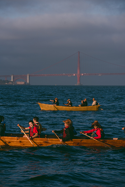 On October 14, 2019, Indigenous Peoples' Day, eighteen canoes representing dozens of tribes, nations, and communities from as far north as the Klahoose First Nation in British Columbia and as far west as the Kanaka Maoli in Hawai'i took to the waters of San Francisco Bay, circling Alcatraz to reclaim the island as a symbol of Native rights. Photo: Marissa Leshnov.