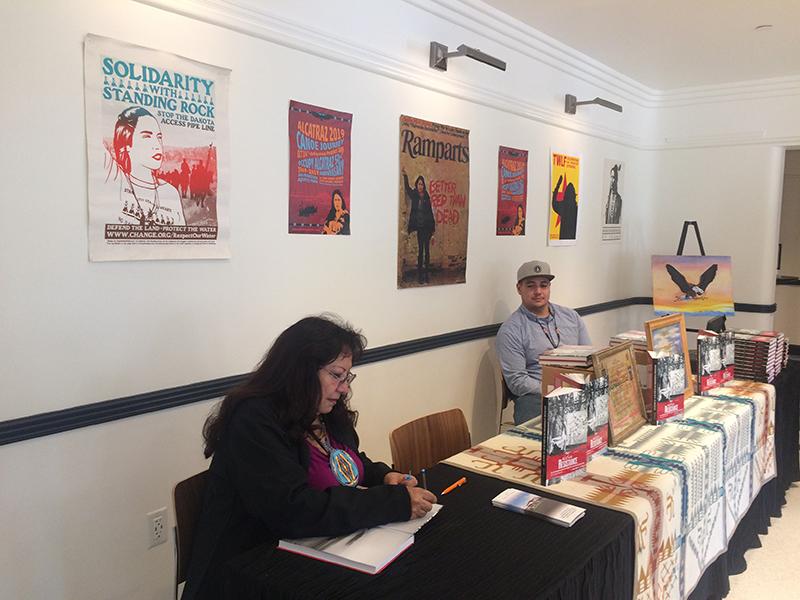 LaNada War Jack signing copies of Native Resistance. Photo: Claudia La Rocco.