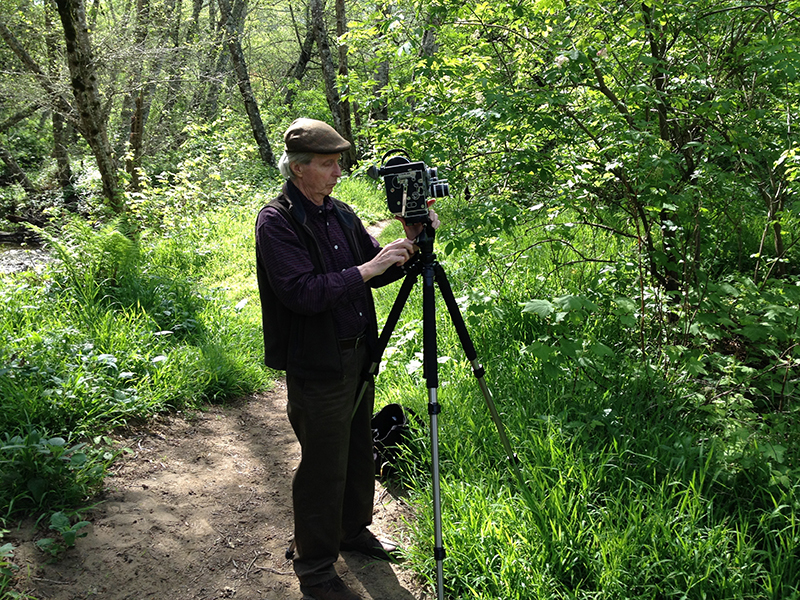 Jerome Hiler in the woods with his camera and tripod, 2016. Photo: Nathaniel Dorsky.