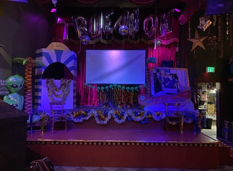 The stage set for TrueAnon's November 21, 2019 event at Make Out Room. Courtesy TrueAnon Pod.