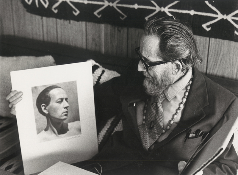 Dane Rudhyar looking at an Edward Weston portrait of himself in the 1920s (exact date unknown). Photo: Betty Freeman. © Los Angeles Philharmonic Association.