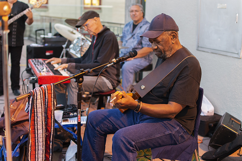 Opening reception of <em>Mike Henderson: Honest to Goodness</em> at San Francisco Art Institute, September 20, 2019. Mike Henderson, guitar; Jerry Long, keyboard; Ed Ramirez, drums; John Rodstad, bass. Photo: Keisha Kidd. Courtesy of San Francisco Art Institute.