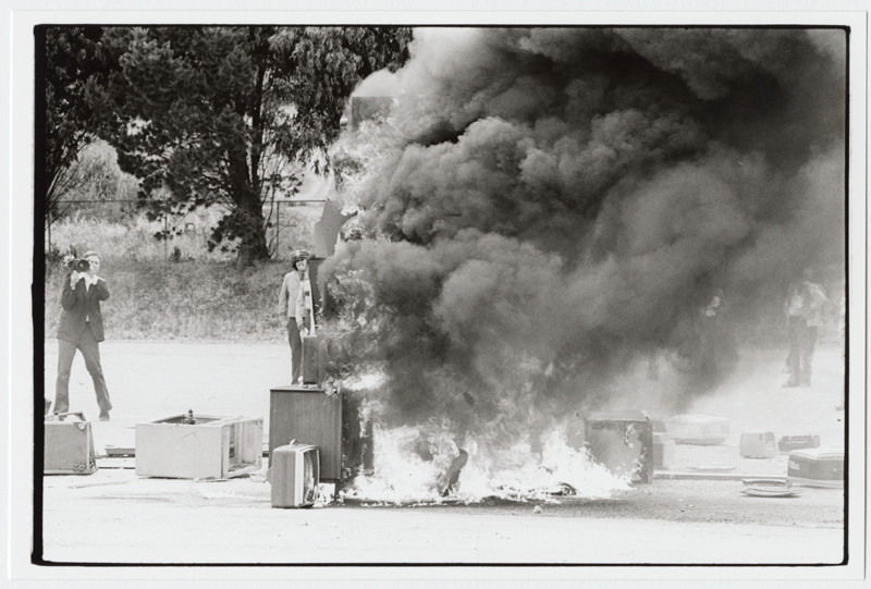 The flaming television sets just post-impact. Notice the noxious smoke of media rising. Photograph by Diane Andrews Hall. From the Ant Farm Archive, housed at the Berkeley Art Museum and Pacific Film Archive.